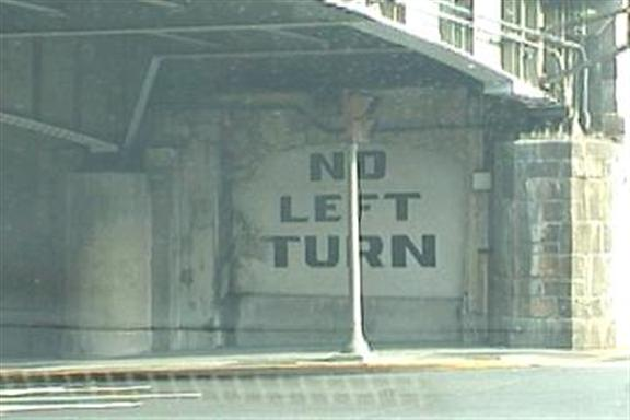 No left turn (painted on a concrete underpass)