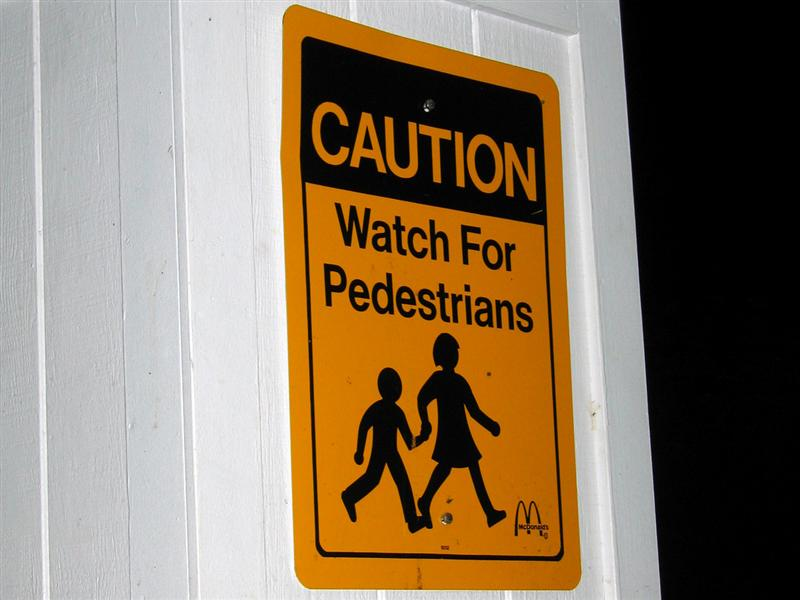 Caution; Watch for pedestrians; McDonalds