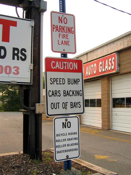 Caution; Speed bump cars backing out of bays