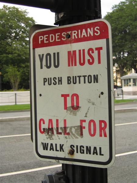 Pedestrians; You must push button to call for walk signal