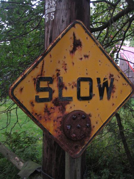 Slow (plain yellow caution sign with glass reflector)