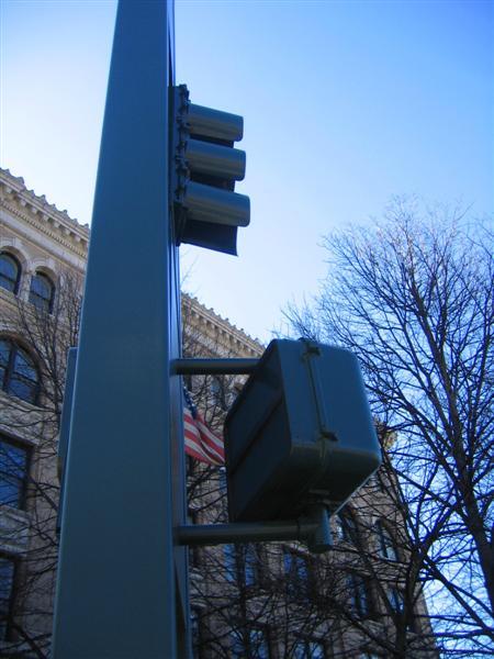 Pedestrian signal head on bus signal post