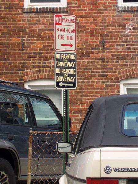 No parking in driveway, No parking in driveway (black sign, white lettering)
