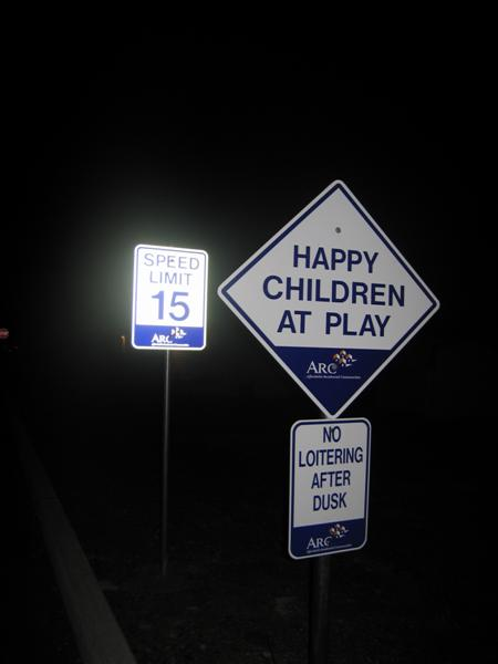 Happy children at play, No loitering after dusk, Speed limit 15 (ARC)